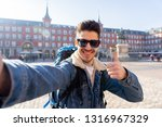 smiling young caucasian tourist ... | Shutterstock . vector #1316967329