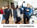 abstract blur people during... | Shutterstock . vector #1316988836