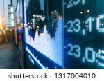 stock market numbers and city... | Shutterstock . vector #1317004010