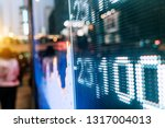 stock market numbers and city... | Shutterstock . vector #1317004013