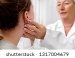 Small photo of Checkup of patient´s lymph node, doctor sweeping for a flu or cold, medical office