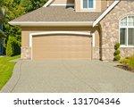 double doors garage with wide... | Shutterstock . vector #131704346