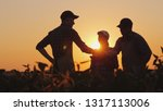 a group of farmers in the field ... | Shutterstock . vector #1317113006