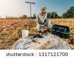 Soil Test. Female Agronomist...