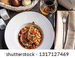 duck confit leg with white bean ... | Shutterstock . vector #1317127469