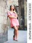 positive  female in pink dress... | Shutterstock . vector #1317226133