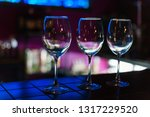 empty wine glasses in row on... | Shutterstock . vector #1317229520