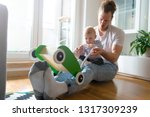 father playing with baby son   Shutterstock . vector #1317309239