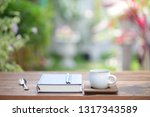 white coffee cup and notebooks... | Shutterstock . vector #1317343589