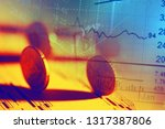 euro coin on stock chart.... | Shutterstock . vector #1317387806