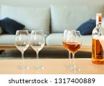 glasses with tasty wine on... | Shutterstock . vector #1317400889