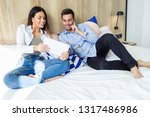 shot of happy young couple... | Shutterstock . vector #1317486986