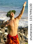 a male hula dancer uses his... | Shutterstock . vector #1317496130