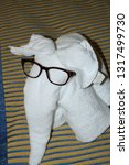 Small photo of St Thomas V.I. August 24,2009 : Customary tile animals left on bed by cabin steward on cruise ships.
