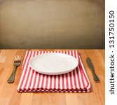 empty plate with silverware on... | Shutterstock . vector #131750150