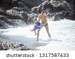father and son playing on the... | Shutterstock . vector #1317587633