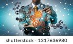 businessman touching virtual... | Shutterstock . vector #1317636980