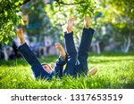 children lying on green grass... | Shutterstock . vector #1317653519