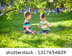 two adorable kid boy making... | Shutterstock . vector #1317654839