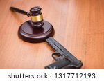 trial for killing with a pistol.... | Shutterstock . vector #1317712193