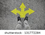 a pair of feet standing on a... | Shutterstock . vector #131772284