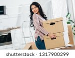 happy latin woman holding boxes ... | Shutterstock . vector #1317900299