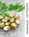 stuffed snails on a plate | Shutterstock . vector #1317926393