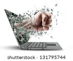 Fist from laptop. Isolated on white background High resolution - stock photo