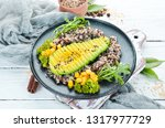 boiled quinoa with avocado and...   Shutterstock . vector #1317977729