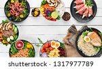 buddha bowl on a white wooden... | Shutterstock . vector #1317977789