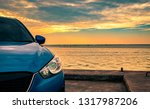 blue compact suv car with sport ... | Shutterstock . vector #1317987206