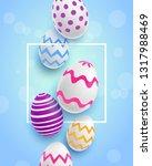 easter eggs. blue background...   Shutterstock .eps vector #1317988469