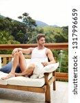 guy in vest and shorts relaxing ... | Shutterstock . vector #1317996659