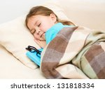 little girl is sleeping in bed... | Shutterstock . vector #131818334