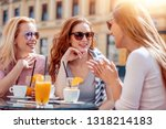 cheerful friends drink coffee... | Shutterstock . vector #1318214183