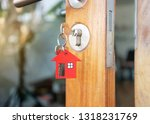 house key in the door with with ... | Shutterstock . vector #1318231769