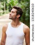 handsome guy in white vest ... | Shutterstock . vector #1318240610