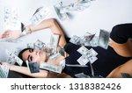 rich sexy woman lies on money.... | Shutterstock . vector #1318382426