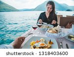 couple eating in restaurant at... | Shutterstock . vector #1318403600