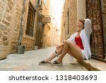 young pretty woman sitting on... | Shutterstock . vector #1318403693