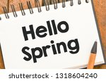 hello spring text in a notebook.   Shutterstock . vector #1318604240