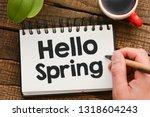 hello spring text in a notebook.   Shutterstock . vector #1318604243