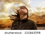 woman with hair blowing in the... | Shutterstock . vector #131863598