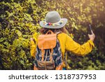a girl with a backpack is using ... | Shutterstock . vector #1318737953