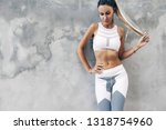 fitness model in sportswear... | Shutterstock . vector #1318754960