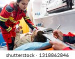 cropped view of paramedic... | Shutterstock . vector #1318862846