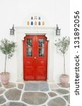 red wooden door surrounded by... | Shutterstock . vector #131892056