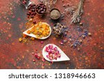 Stock photo aromatic dried flowers with and rose hips and herbs on color table 1318946663