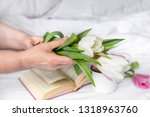 white and pink tulips in women... | Shutterstock . vector #1318963760