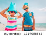 happy girl and boy play with... | Shutterstock . vector #1319058563